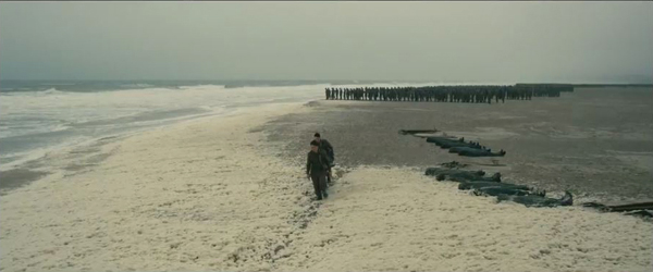 Dunkirk, hero with stretcher on beach