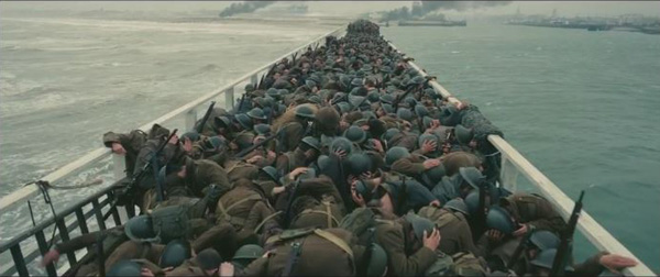 Dunkirk, soldiers ducking, ships background