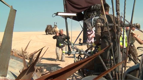 Miller directing in desert