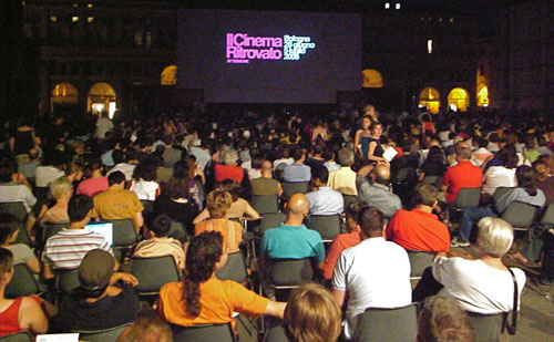 A vast crowd assembles for the nightly screening on the Piazza Maggiore.
