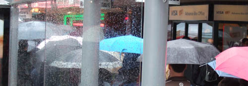 umbrellas-and-rain-widescreen-500.jpg